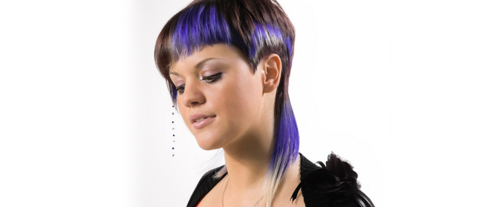 Woman with colour highlights and modern cut