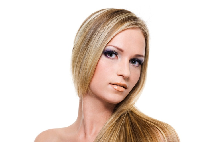 Woman with long blonde hair with corrected highlights colour