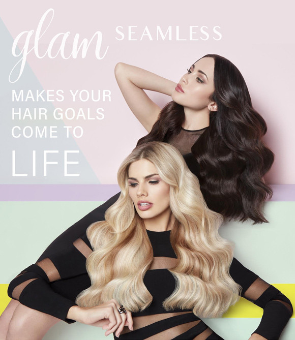 One dark haired woman and one blonde haired woman with long and curly Glam Seamless hair extensions posing.