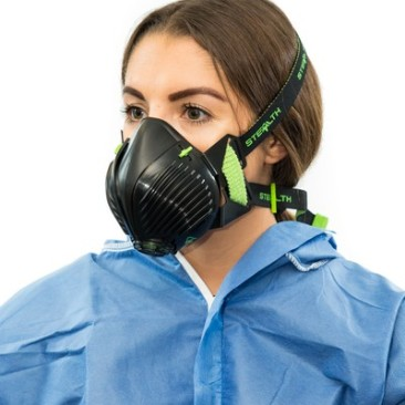 Woman wearing protective gear and respirator type mask